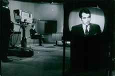 A view of a studio with men sitting and giving interviews on Paris TV, 1969.
