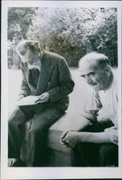 Unbiased news for Florence, two old man have sitting together, while one of them is reading newspaper 1944