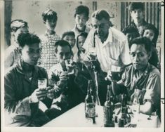 A photographer joining in a toast with Viet Cong and South Vietnamese soldiers during Vietnam War