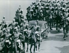 King Gustaf V travelling in vehicle along with the guards.