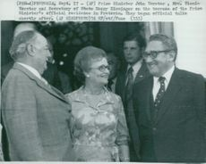Prime Minister John Vorster and his wife Tienie Vorster with Henry Kissinger on the terrace to the prime minister's official residence