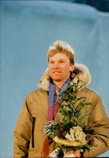 Vladimir Smirnov on the prize pool after his win in 50 km cross country skiing