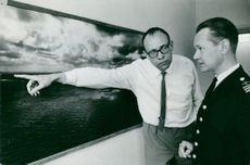 Lars Ramsten points to a picture of the area where captain Sven Brise patrolled with Furir E. H. Nordlund