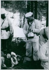 Soldiers cooking in the forest during the Norwegian Campaign, 1940.