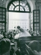 This photo was taken during the marriage ceremony of Princess Birgitta of Sweden and Prince Johann Georg of Hohenzollern.