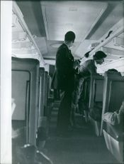 Air hostess and flying officers in the airplane.