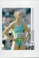 Ludmila Engquist looks up at the scoreboard after the first 100m hatch attempt at the Atlanta Olympic Games in 1996