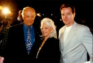 """Bryan Cranston along with Buss Aldrin and his wife Lois at the premiere of """"From Earth to the Moon""""."""