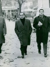 French politician Pierre Mendes France is walking with a unknown men on the street