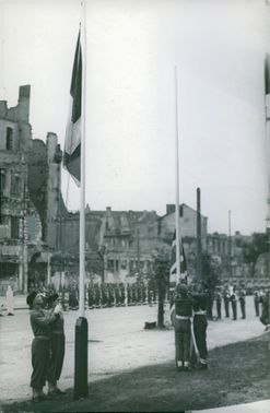 SOLDIERS RAISING FLAG ON HIGH