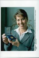 Magdalena Forsberg was awarded the HM King's medal of the 8th size in high-blue bands.