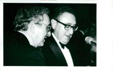 Henry Kissinger and his brother Walter at his birthday celebration at Waldorf's Astoria