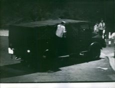 Police vehicle moving at night and patrolling. 1972