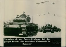 Soldiers moving and marching with their tanks and aircraft flying in Hungary during World War II.