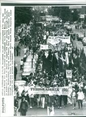 People in procession. 1981