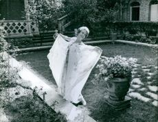 Gisèle Pascal dancing and enjoying while at the garden.