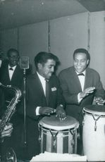 Sammy Davis playing instruments with a band.  - May 1963