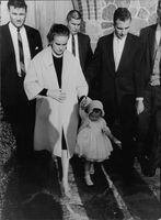 Marina Oswald wife of Lee Oswald (JFK assassin) carries her daughter during the funeral of her husband Lee, 1963