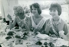 Miss Sweden with Miss England and Miss France dining, 1961.