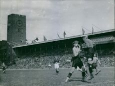 People playing rugby in stadium.1936.