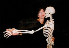 "Actress Ika Nord with the skeleton Åke in the performance ""Apan"" at Dansens hus"