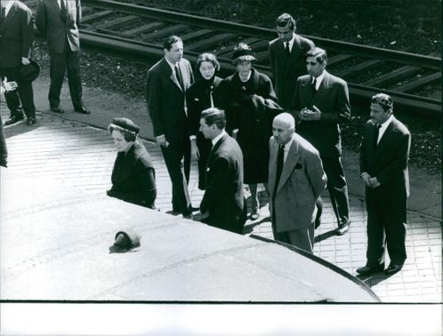 Bettina Graziani at railway station with people.