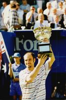 Andre Agassi proudly shows his cup after the win during the Australia Open.
