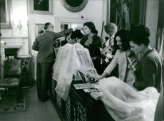 Miss World 1963 contestants browsing reading materials in a bookstore.