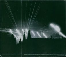 Anti-aircraft batteries fire level streaks from Hotel roof and beyond red square after Russian Civil War.