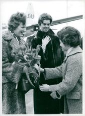 Princess Margrethe of Denmark in the company of Princess Margaretha, receives flowers of a young Danish in Stockholm on the Brommafältet