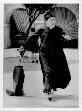 """Fernandel as Don Camillo in the movie """"Don Camillo and the teenagers""""."""