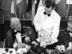 Field Marshal Montgomery being served by a waiter.