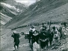Migratory walking on the Himalaya's mountain with the luggage.1967