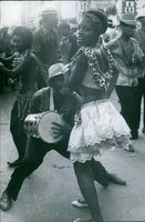 Man and woman dancing and playing music on the road.