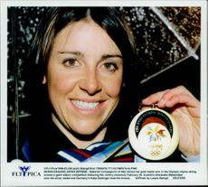 Italian slalom player Deborah Compagnoni shows his gold medals for the grand slalom during the Winter Olympics 1998