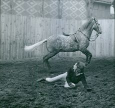Irène Tunc, French actress and model, seen falling from the horse. 1961.