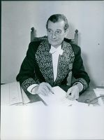 French novelist and filmmaker Marcel Pagnol working in his office
