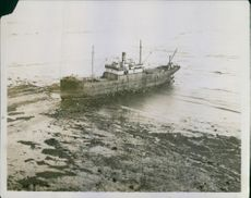 1931 A vintage photo  of a ferry on the water.