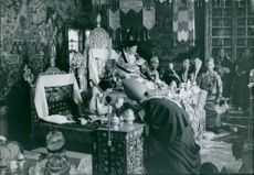 Palden Thondup Namgyal and Hope Cooke, King and Queen of Sikkim, sitting on their thrones. 1965.