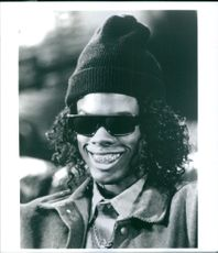 "Portrait of Chris Rock as Albert/MC Gusto smiling, from the film ""CB4"", 1993."