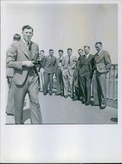 People standing in row for photoshoot. 1939