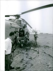 View of soldiers coming out of helicopter.