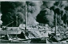 Many small craft were burned in the fires that swept probolinggo harbour, but the boats on the foreward side the dock appeared secure at the time this picture was taken, 1944.