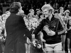 Stockholm Open Final. Winner Mark Cox is congratulated by former tennis star Curt Nielson
