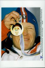Austrian skier Hermann Maier holds up his gold medal as he won in Super-G during the Winter Olympics 1998