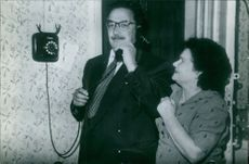 Valentina Vladimirovna and her husband have a phone call.