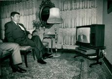 Soviet Union ambassador in Sweden, Boris Pankin, looks when leader Michail Gorbatjov talks about the nuclear accident on television