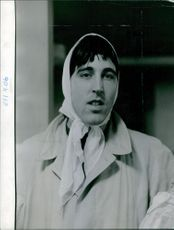 A photo of a man with the handkerchief in his head.