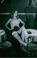 1967  A photo of a French actress Danielle Gaubert relaxing in a bar.