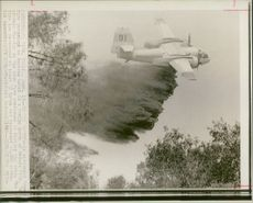 an air tanker drops are retardant on burning.